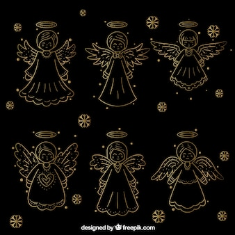 Inzameling van hand-drawn gouden kerstmisengelen