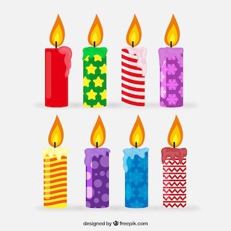 Inzameling van kleurrijke kerstmiskaarsen