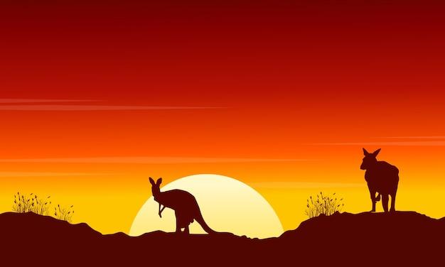 Inzamelingskangoeroe bij het landschap van het zonsondergangsilhouet