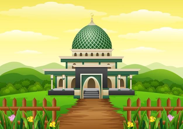 Islamitische moskee gebouw met groene koepel in de tuin