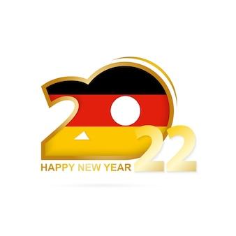 Jaar 2022 met het patroon van de vlag van duitsland. gelukkig nieuwjaar ontwerp.