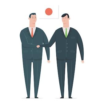 Japanse zakenmanhanddruk met een zakenpartner