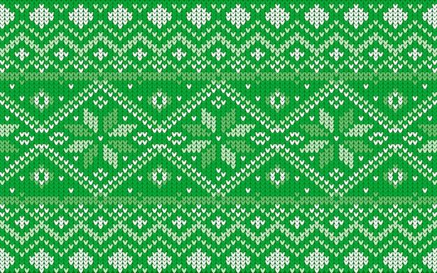 Jaquardpatroon voor kerstmis met sneeuwvlokken in groen
