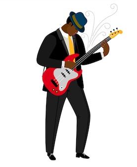 Jazzgitarist in hoed met muziekinstrument