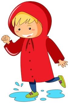 Jong geitje in rode regenjas die in vulklei springt