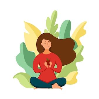 Jong gelukkig meisje mediteren in lotushouding met appel in haar armen veganistisch concept. vector vlakke stijlillustratie van vegetarische ontspannen vrouw in een gezonde, natuurvriendelijke voedsellevensstijl