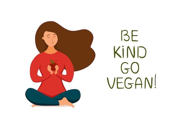 Jong gelukkig meisje mediteren in lotushouding met appel in haar armen veganistisch concept. vlak