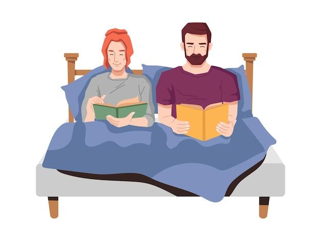 Jong koppel in bed boeken lezen voor het slapen