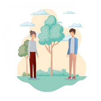 Jong koppel in landschap met bomen en planten