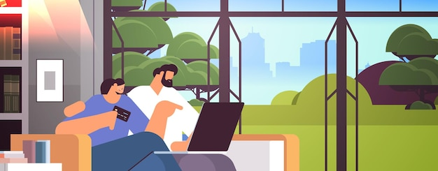 Jong koppel met creditcard met behulp van laptop online winkelen concept man vrouw samen bestellen van goederen moderne woonkamer interieur horizontaal portret