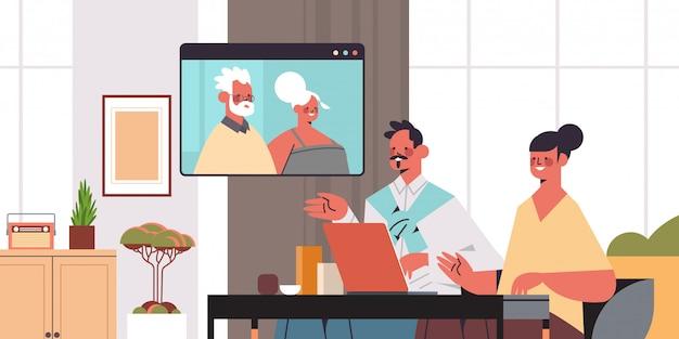 Jong koppel met virtuele ontmoeting met grootouders tijdens video-oproep familiechat online communicatieconcept portret horizontale illustratie