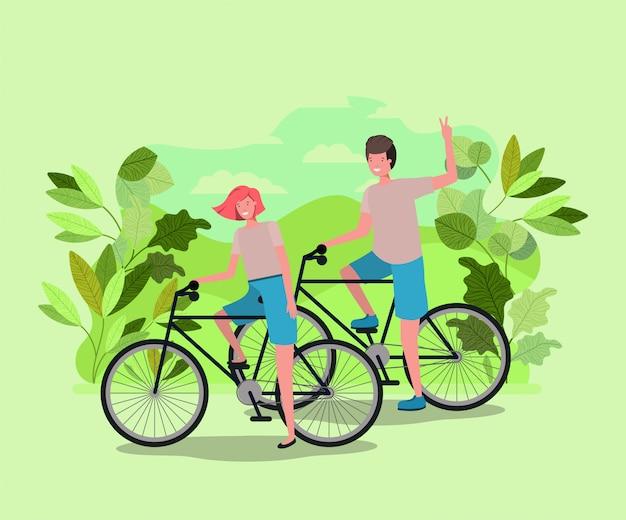 Jong koppel op de fiets in het park