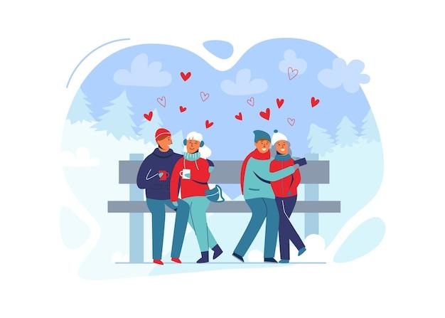 Jong koppel verliefd in winterkleren op besneeuwde landschap. gelukkig man en vrouw samen in park met kerstbomen.