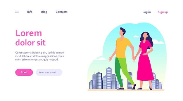 Jong koppel wandelen in de stad. man en vrouw hand in hand. burgers, buitenactiviteiten, dating in stadsconcept voor websiteontwerp of bestemmingswebpagina