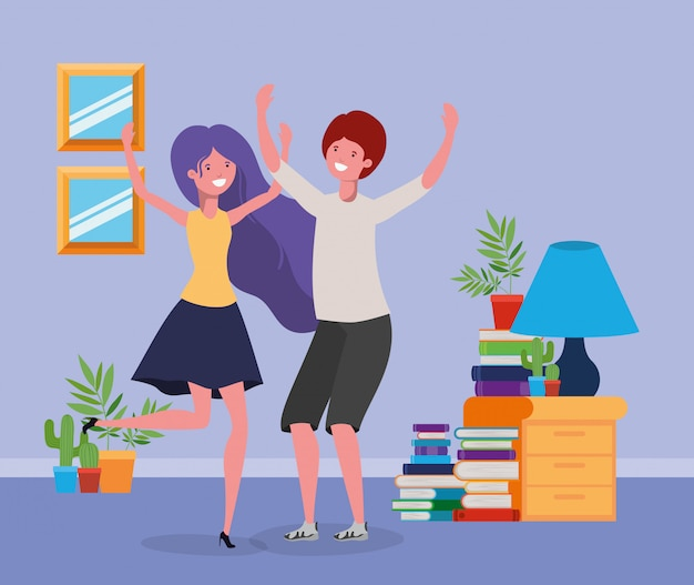 Jong paar dansen in de woonkamer