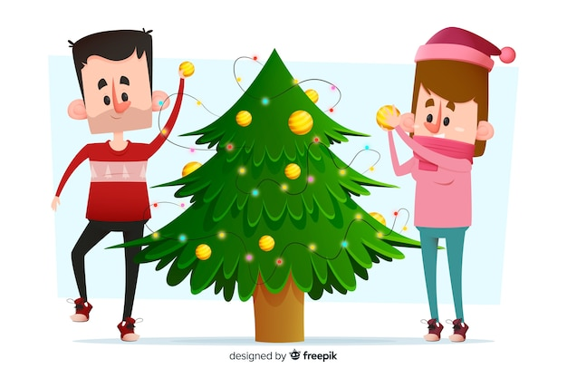 Jong volwassen paar dat de kerstmisboom verfraait
