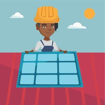 Jonge afrikaanse aannemer die zonnepaneel installeert.