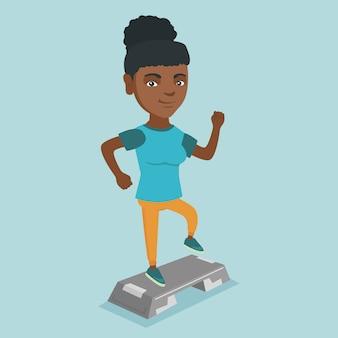 Jonge afro-amerikaanse vrouw die op steiler uitoefent