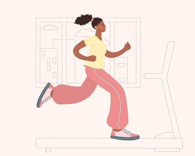 Jonge afro-amerikaanse vrouw die thuis op een loopband loopt sport thuis