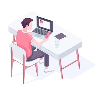Jonge blanke man aan het werk in een modern kantoor.