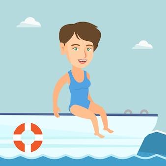 Jonge blanke vrouw looien op een zeilboot.