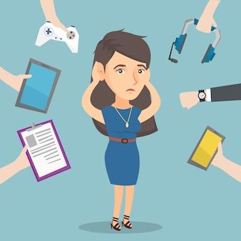 Jonge blanke vrouw omringd door haar gadgets.