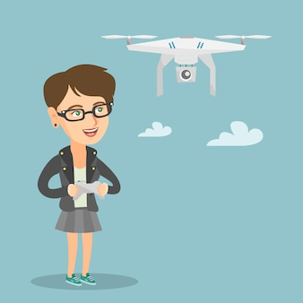 Jonge blanke vrouw vliegende drone.