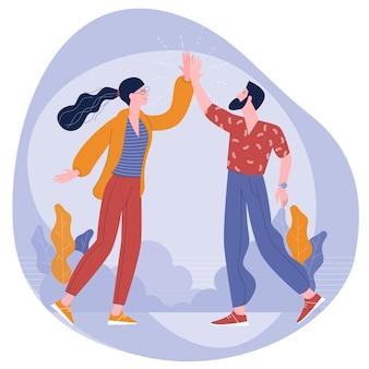 Jonge collega's man en vrouw geven elkaar vijf
