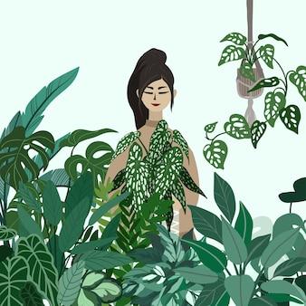 Jonge dame met een pot met plant