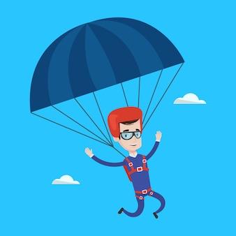 Jonge gelukkige mens die met valscherm vliegt.