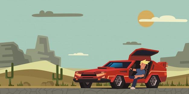 Jonge glimlachende kerelzitting in rode raceauto op woestijn