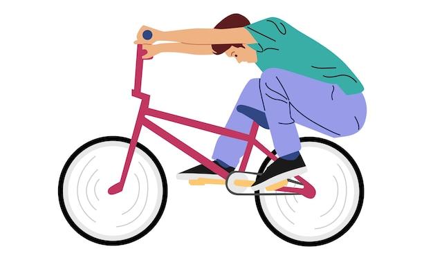 Jonge jongen die met vrije slagtruc met fiets pronkt