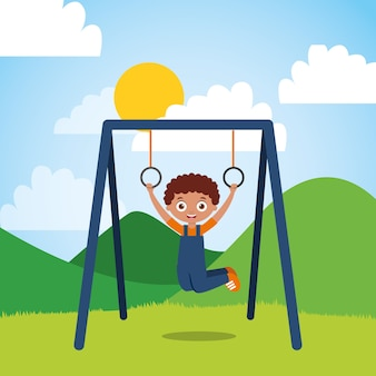 Jonge jongen het hangen ringenstaaf in de park zonnige dag