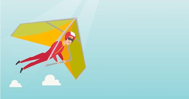 Jonge kaukasische mens die op deltavlieger vliegt