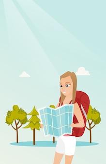 Jonge kaukasische reizigersvrouw die kaart bekijken.