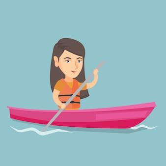 Jonge kaukasische vrouw die door kajak reist.