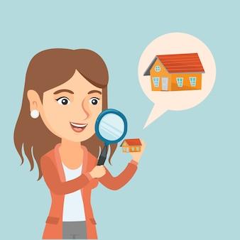 Jonge kaukasische vrouw die een huis zoekt.