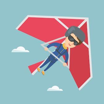 Jonge kaukasische vrouw die op deltavlieger vliegt.