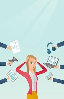 Jonge kaukasische vrouw omringd door haar gadgets