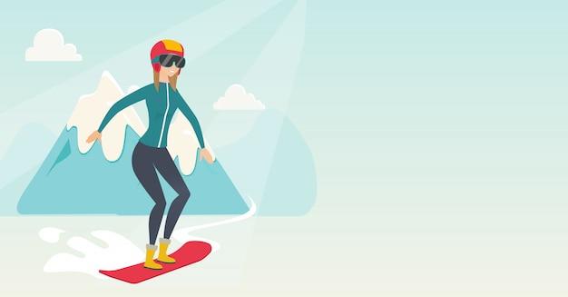 Jonge kaukasische vrouw snowboarden.
