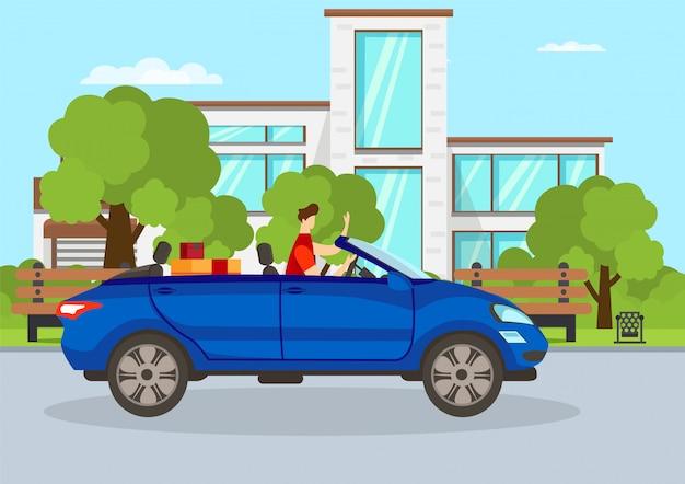 Jonge kerel die blauwe cabriolet auto in stad drijft.