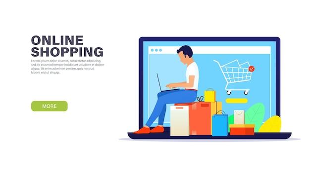 Jonge kerel met laptop zittend op dozen aankopen en online winkelen