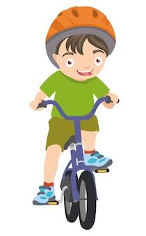 Jonge kleine jongen speelt met zijn fiets