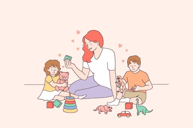 Jonge lachende vrouw leraar en gelukkige peuters kinderen jongen en meisje piramide bouwen met hoepels op de kleuterschool of thuis