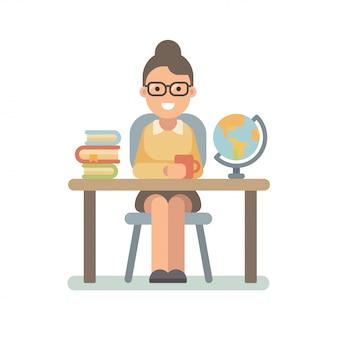 Jonge leraar zit aan de balie met een stapel boeken en een wereldbol.