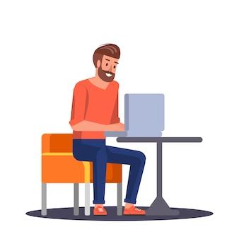 Jonge man aan het werk in de laptop
