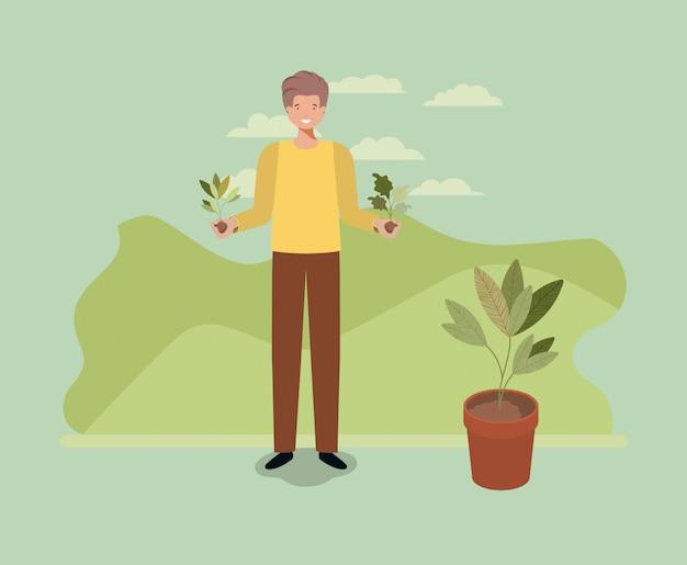 Jonge man aanplant boom in het park