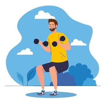 Jonge man doet oefeningen met halters buiten, sport recreatie concept