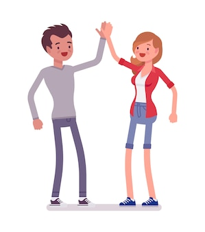 Jonge man en vrouw die high five geven