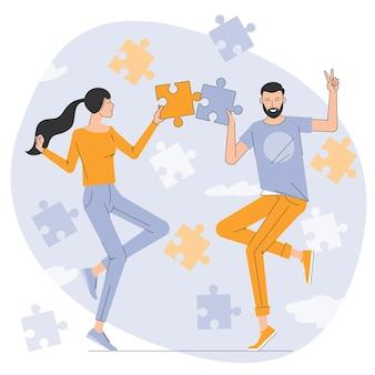 Jonge man en vrouw die puzzel in elkaar zetten